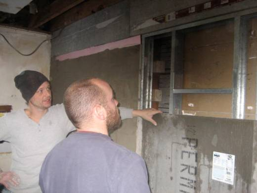 Adam Gauvin and Jeremy Brown, lead mason, consult