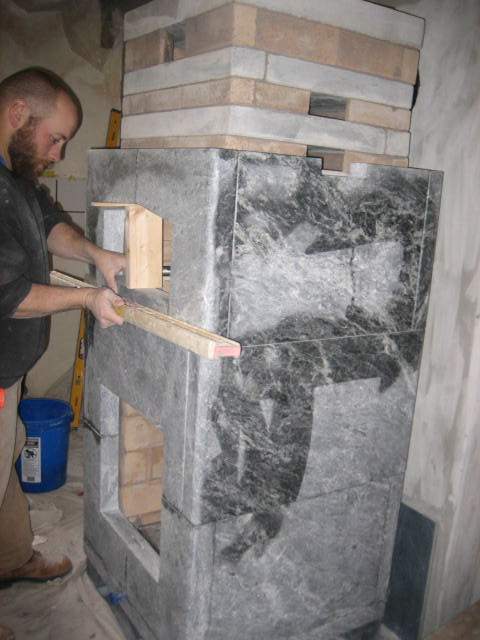 Soapstone cladding going on