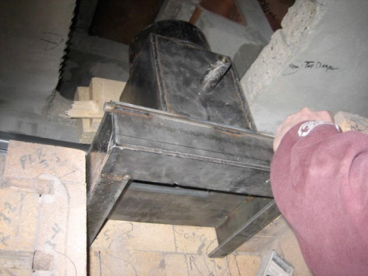 Seating the flue damper assembly in line with the chimney